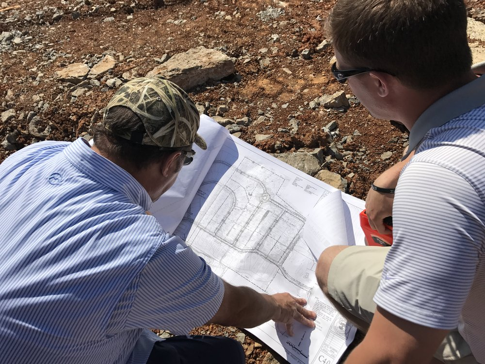 DAC President, Joe DeFatta, and Vice President, David DeFatta, evaluate company lots in The Woods at Burberry Glen.