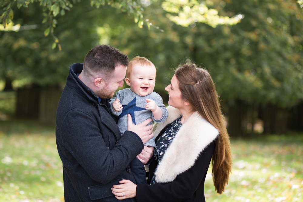 Baby with his mummy and daddy on a lifestyle family photoshoot in Dunham Massey, Cheshire. Gorgeous Autumn Light