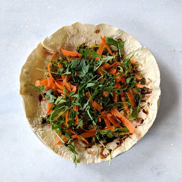 Veggin out on a tortilla with a little sharp cheddar, sauteed Brussels sprouts and onions, shaved carrot, arugula, and balsamic vinegar! 🥕🌱 This quick meal idea is great because you can bulk it up or keep it light-- whichever you prefer or need! Add some chicken or tofu on top, or load up on veggies. If you give it a try, let me know!!