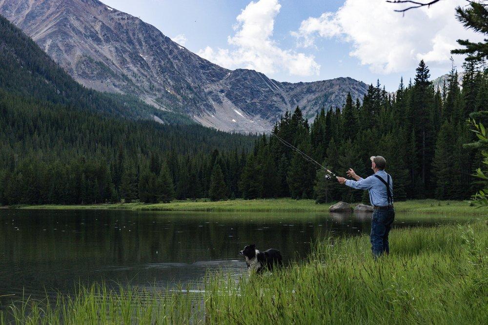 Tom and his dog fishing at Twin Lakes, MT