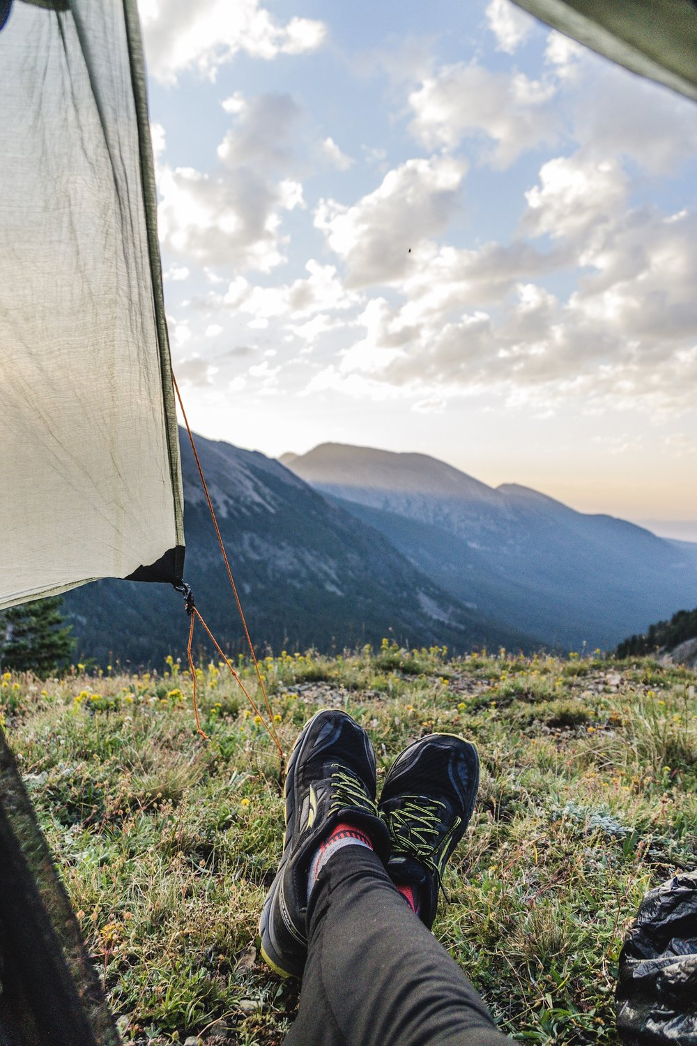 Enjoying the sunrise from my tent at Goat Flats. Altra LP 3.0 and Balega Socks.