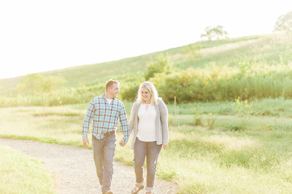 couple walking seven islands state birding park knoxville engagement winx photo