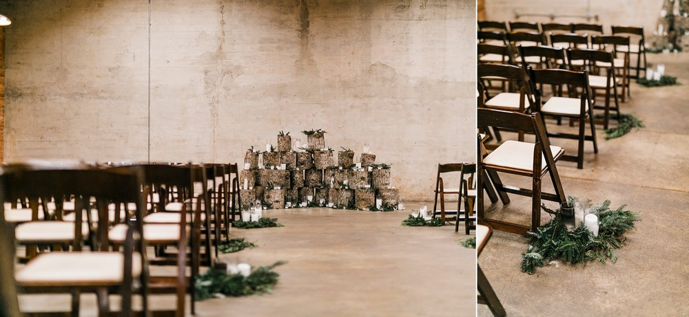 woodland aisle decor with candles and dark wood chairs