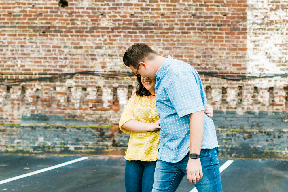 yellow and blue engagement session colors walking in parking lot downtown knoxville