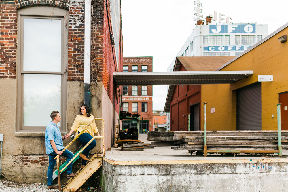 casual engagement session outfits beside traintracks and jfg building in the old city knoxville