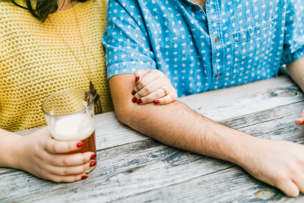 couple with beer engagement session