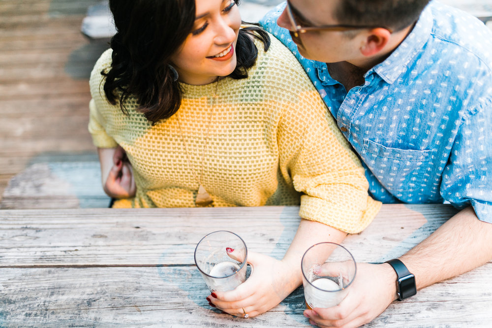 couple drinking beer casual engagement session