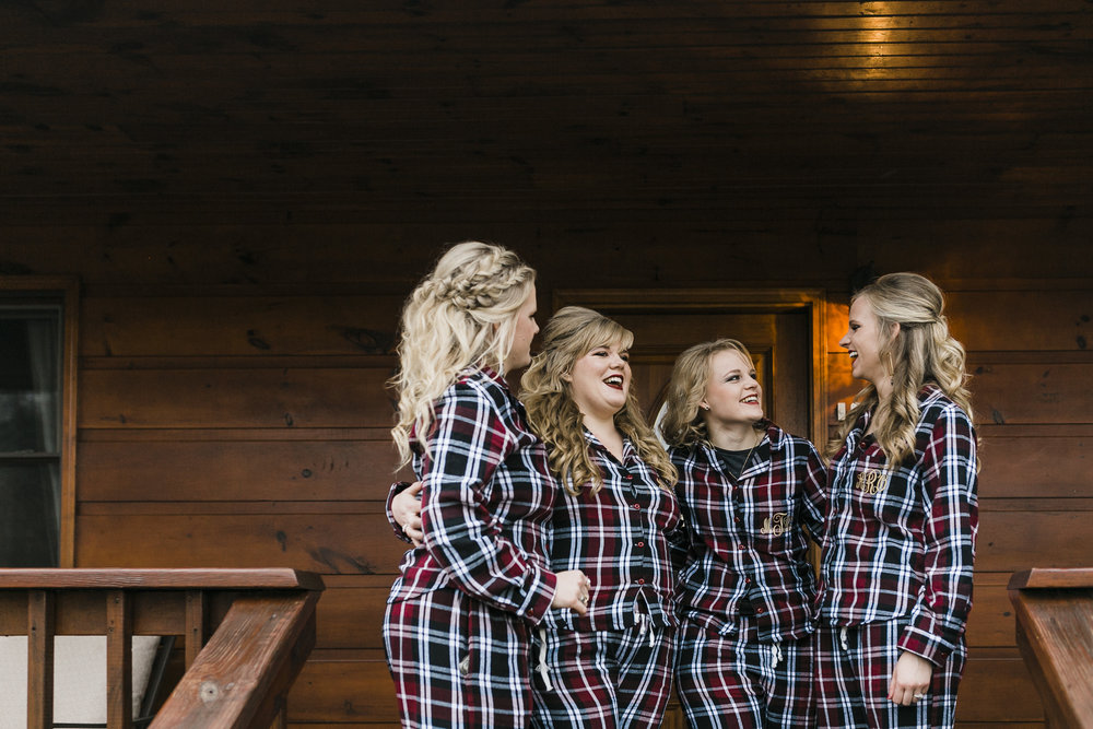 bridesmaids in flannel pajamas at berry spring lodge