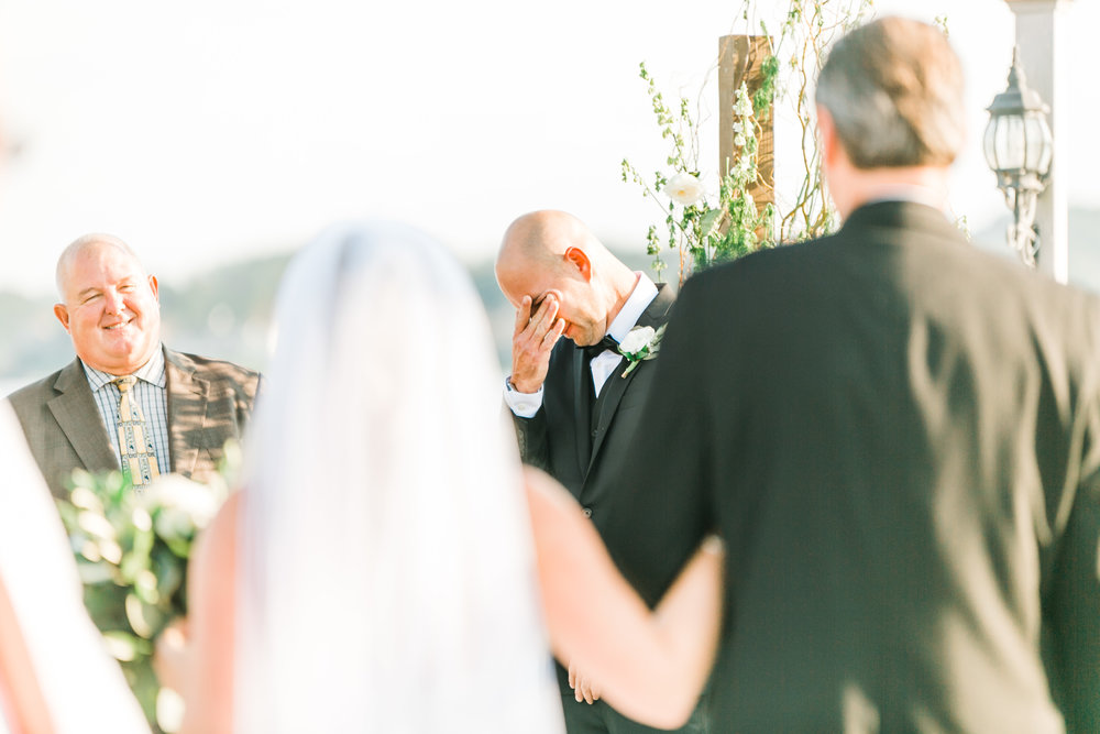 groom crying during first look
