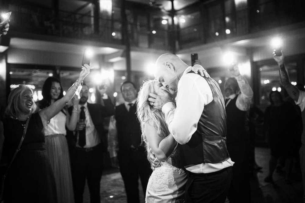 bride and groom dancing in flash light circle at wedding tellico village yacht club