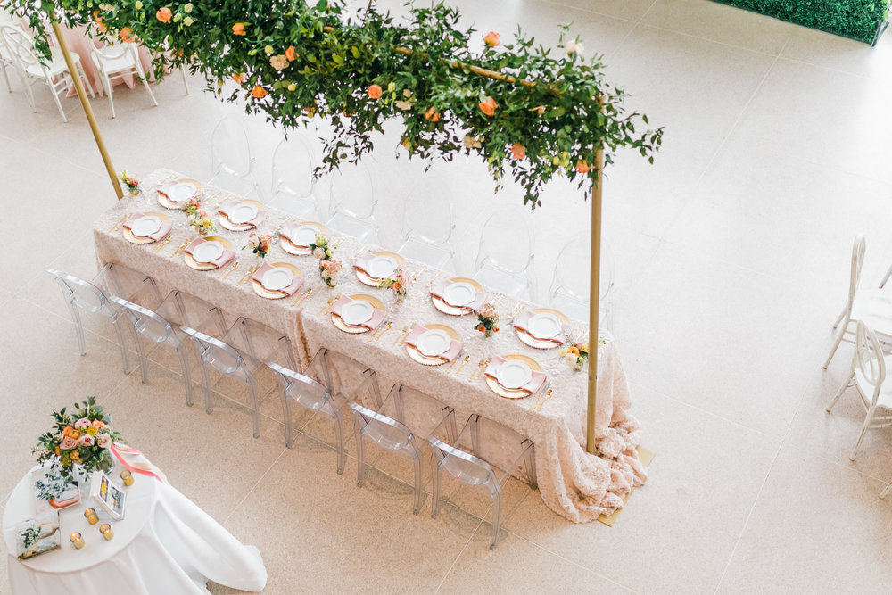 statement head table at the knoxville museum of art greenery and pink