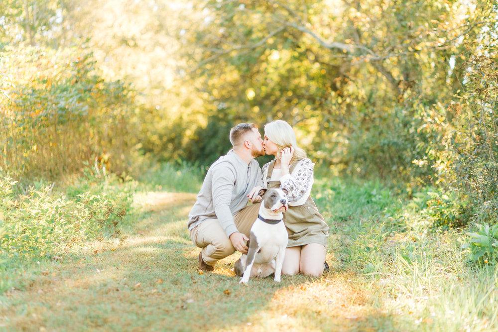 sunset engagement couple with pitbull