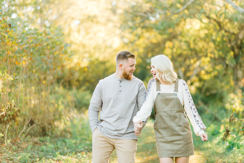 fun young couple engagement photos sunset glow melton hill park knoxville