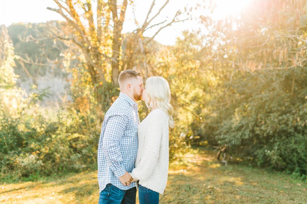 couple kissing golden hour melton hill park