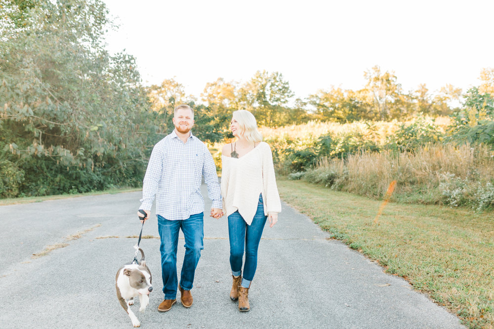 couple walking with pitbull knoxville tn melton hill park engagement