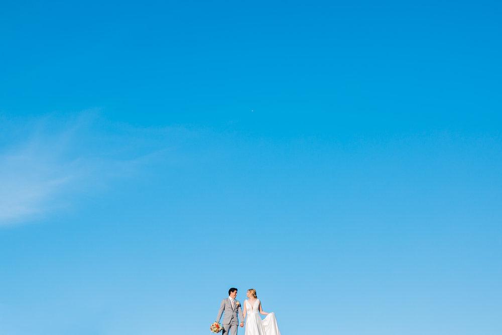 big blue skies and wedding couple full sun maypop fields east tn wedding venue