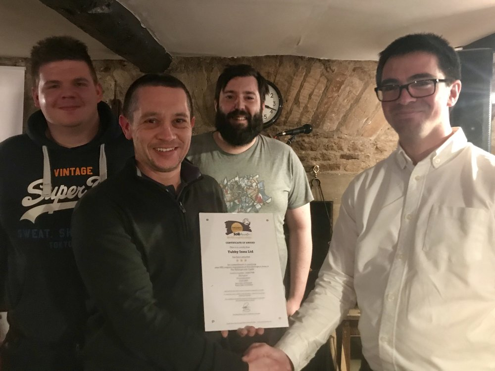Corey, Darral and ill receiving the award from the Soil Association's Mark Machin