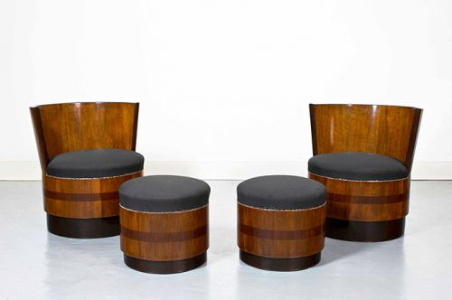A stunning pair of Art Deco French barrel armchairs with footstools