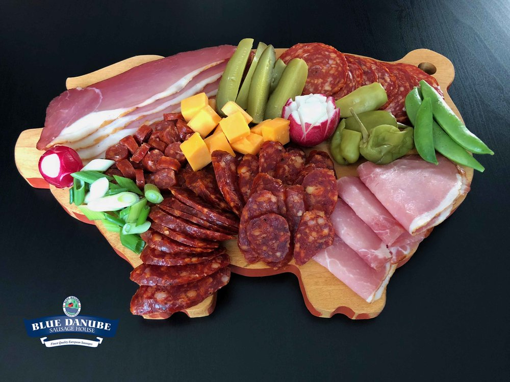 Small Charcuterie Board #1 - Feeds 3-4 people  Using 1/2 package of all sliced meat products, 1 piece Wild Boar Csabettes, 1 piece Hot Gyulai Sausage