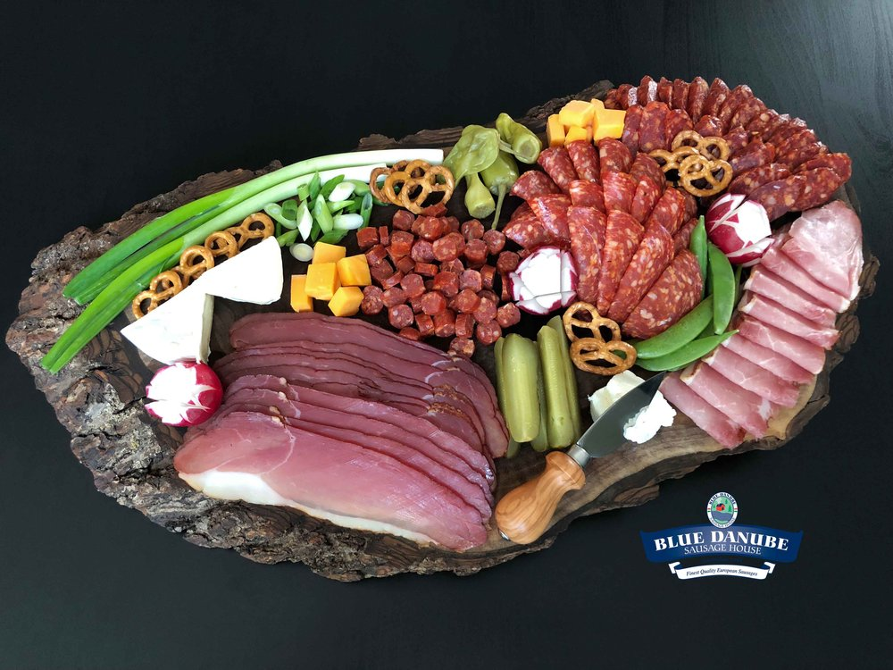 Small Charcuterie Board #2 - Feeds 5-8 people  Using full packages of all sliced meat, 2 pieces Wild Boar Csabettes, 1 piece Hot Gyulai Sausage