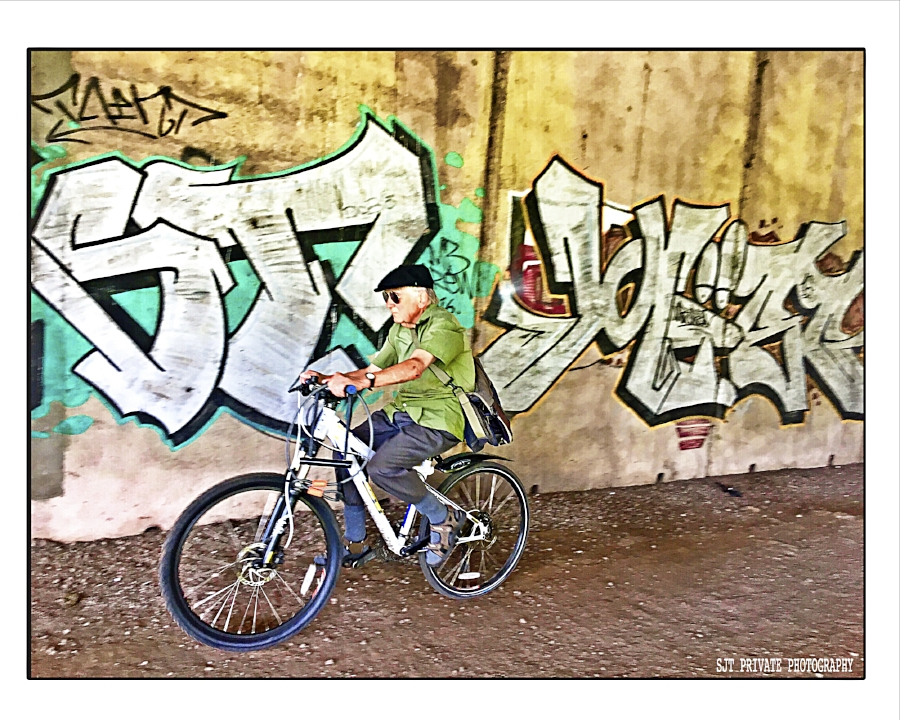 MAN ON BIKE UNDER GRAFITTI BRIDGE COLOUR.jpg