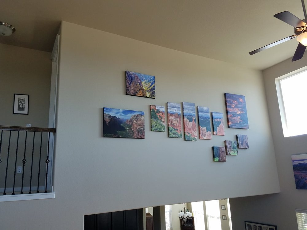 THIS 2 STORY WALL WAS A LITTLE TRICKY TO FIGURE OUT LAYOUT AND WHAT WOULD LOOK GOOD. WE PHOTOSHOPPED THE ARTWORK ONTO THE WALL BEFOREHAND SO WE COULD WORK OFF OF A CONCEPT AND GENERAL IDEA FOR PLACEMENT. IT WORKED GREAT ON ALL THESE HIGH WALLS!