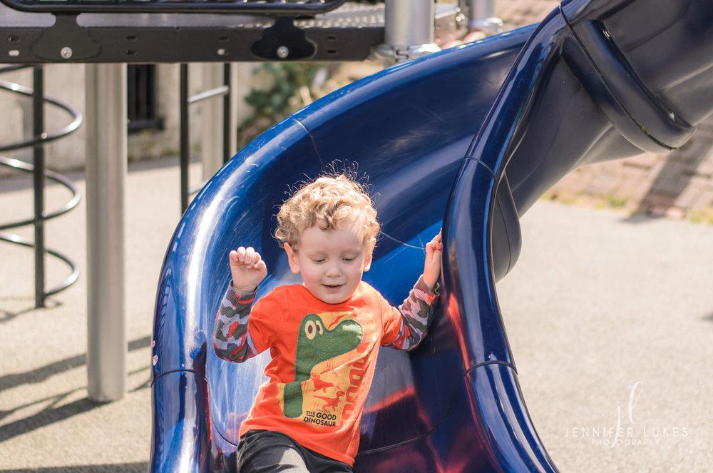 Boy at Bottom of Slide Luther Burbank Park