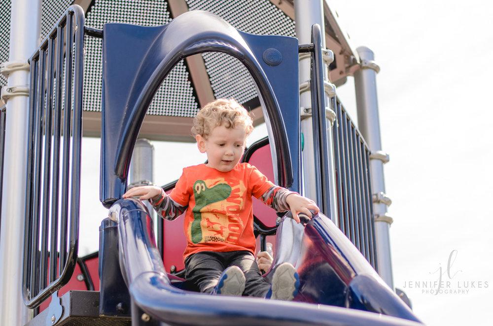 Boy at Top of Slide Luther Burbank Park