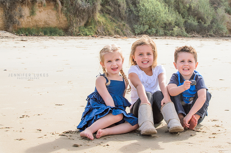 Shooting in full sun can cause really bright highlights and really dark shadows. By having these kids face their shadows, I was able to avoid harsh lights and darks on their faces and squinting has been minimized.
