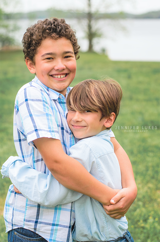 Shooting on cloudy days is something we need to master here in Seattle. You can see in this photo of these hugging brothers that the clouds have diffused the lighting, and there are no harsh shadows to be seen.