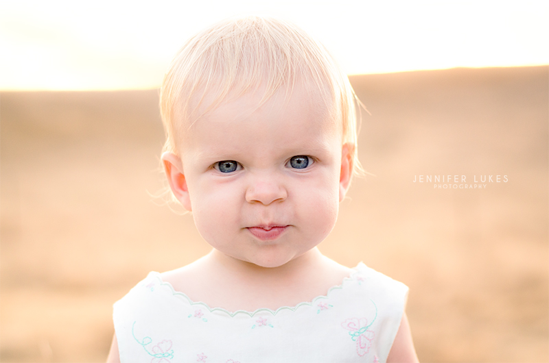 The magic of golden hour is evident in this baby girl's photo. You an see the warm golden tones throughout the image and the halo of soft light that surrounds her.