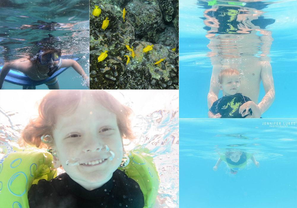 Seattle children enjoying underwater time on their Hawaiian vacation.