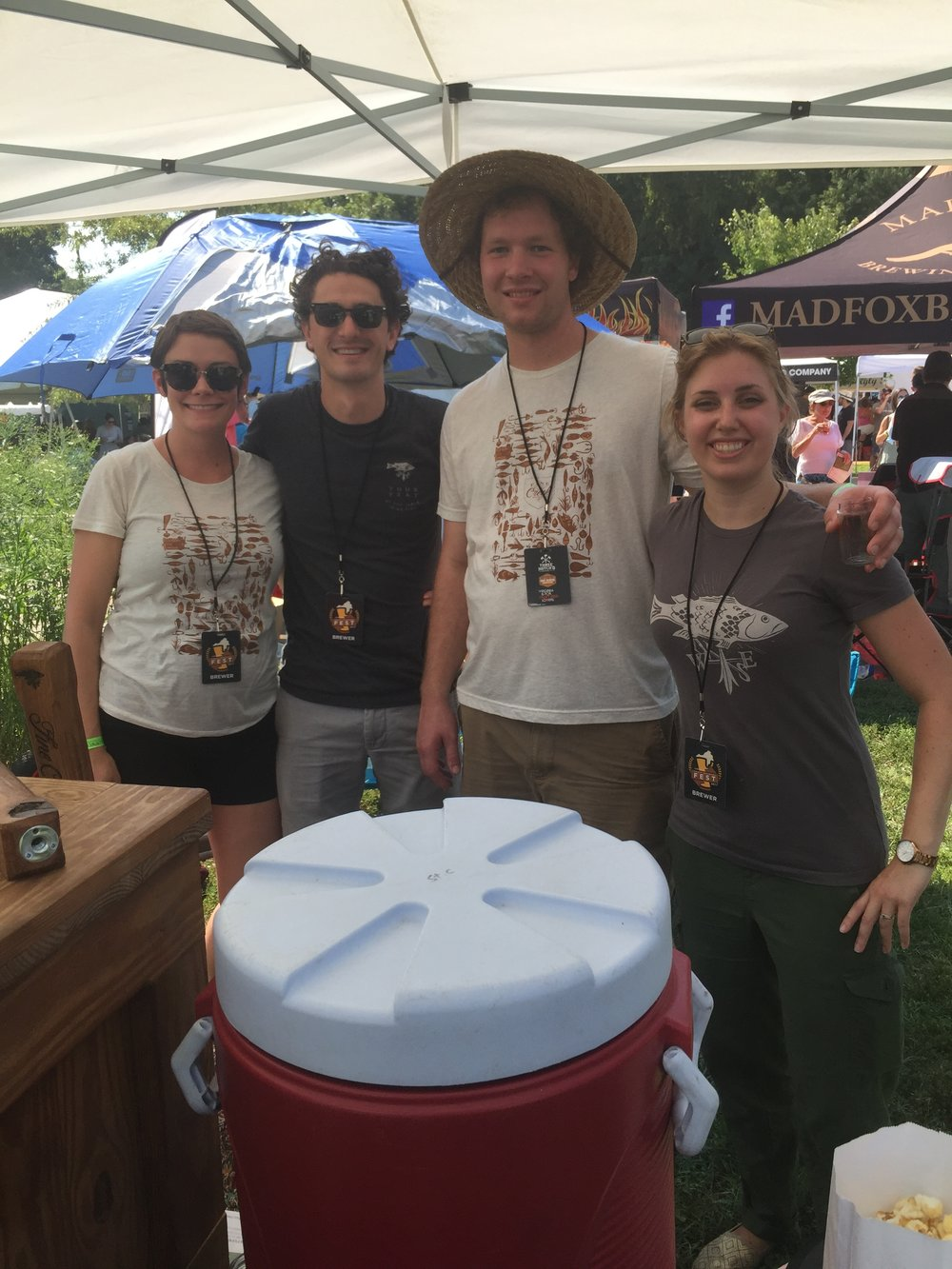 Fine Creek Brewing 's Mark Benusa and Gabe Slagle got assistance from their wives at the festival.
