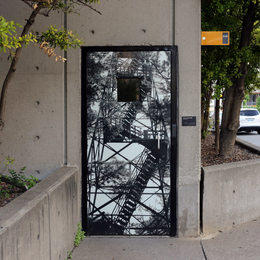 """Jacob's Ladder #0351"" by Michael Winters on a door at 7th and Jefferson, Louisville, KY"