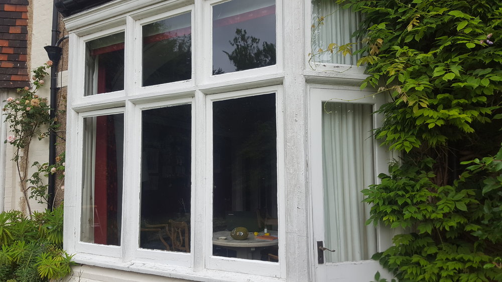 Windows BEFORE Dorking Decorators painted them