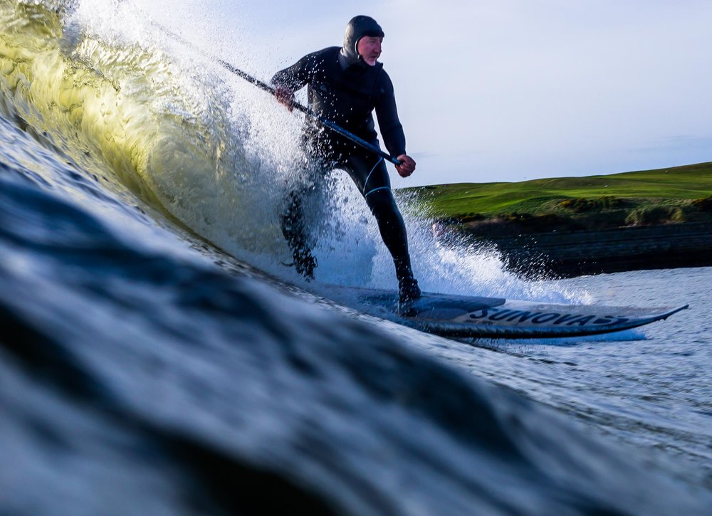 Stand up paddleboarding Aberdeen waves.