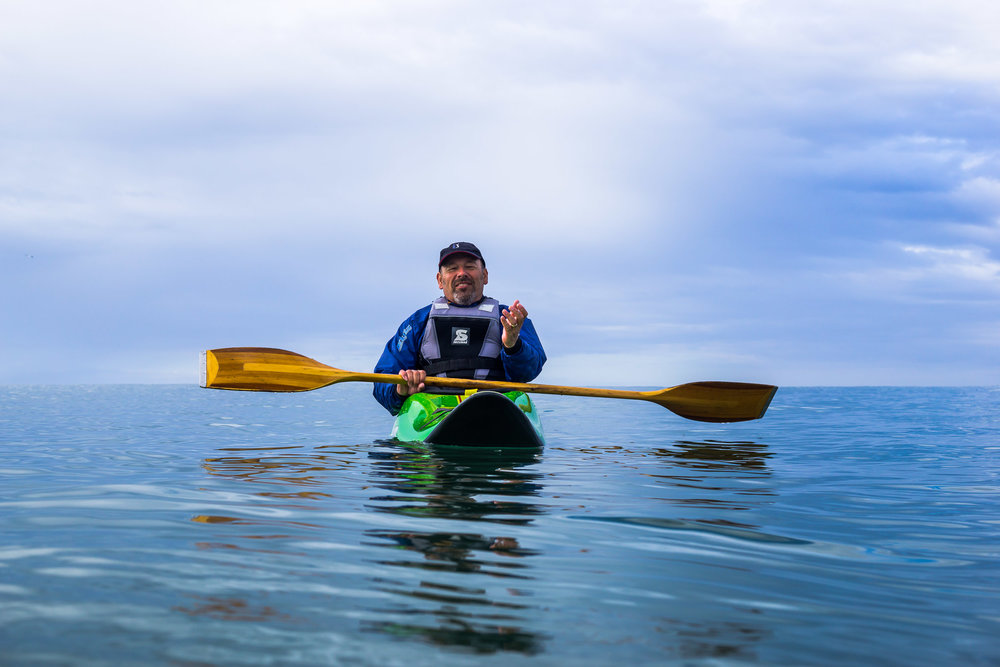 Surf kayaker waiting for the next wave at Sandend.