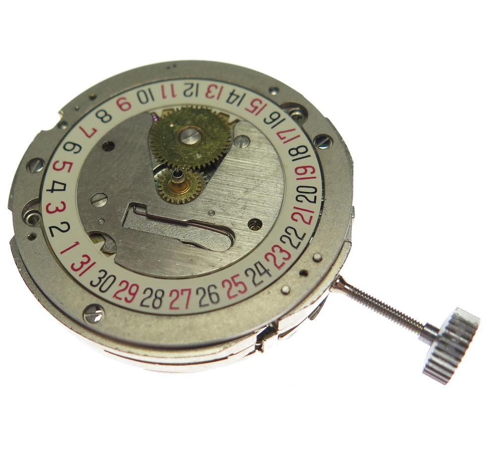 Under dial. Showing the calendar mechanism.