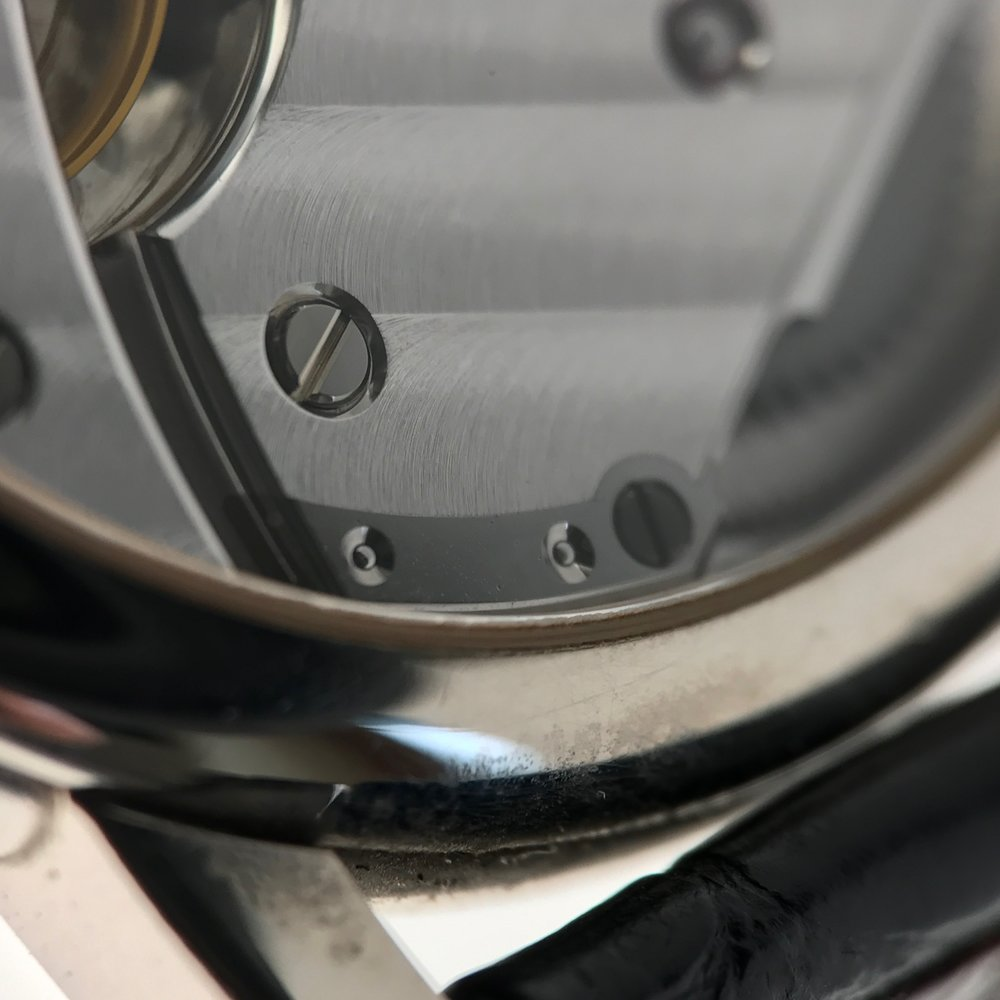Click. The foot of the click shown in the centre is fitted level with the barrel bridge and held in place by 2 pins and a screw.