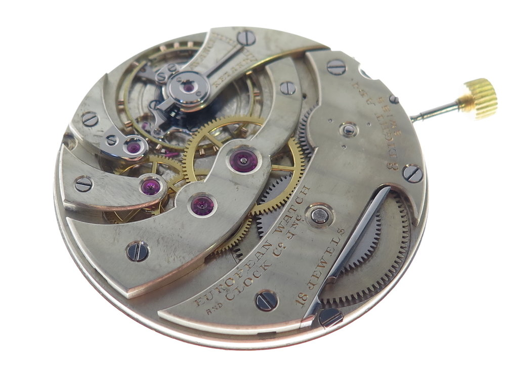 All of the rubies in the calibre as with all found in a functional capacity in watch movements are synthetic. These seen here are 'rubbed' in, in a sense riveted in place therefore not allowing for any future adjustment.