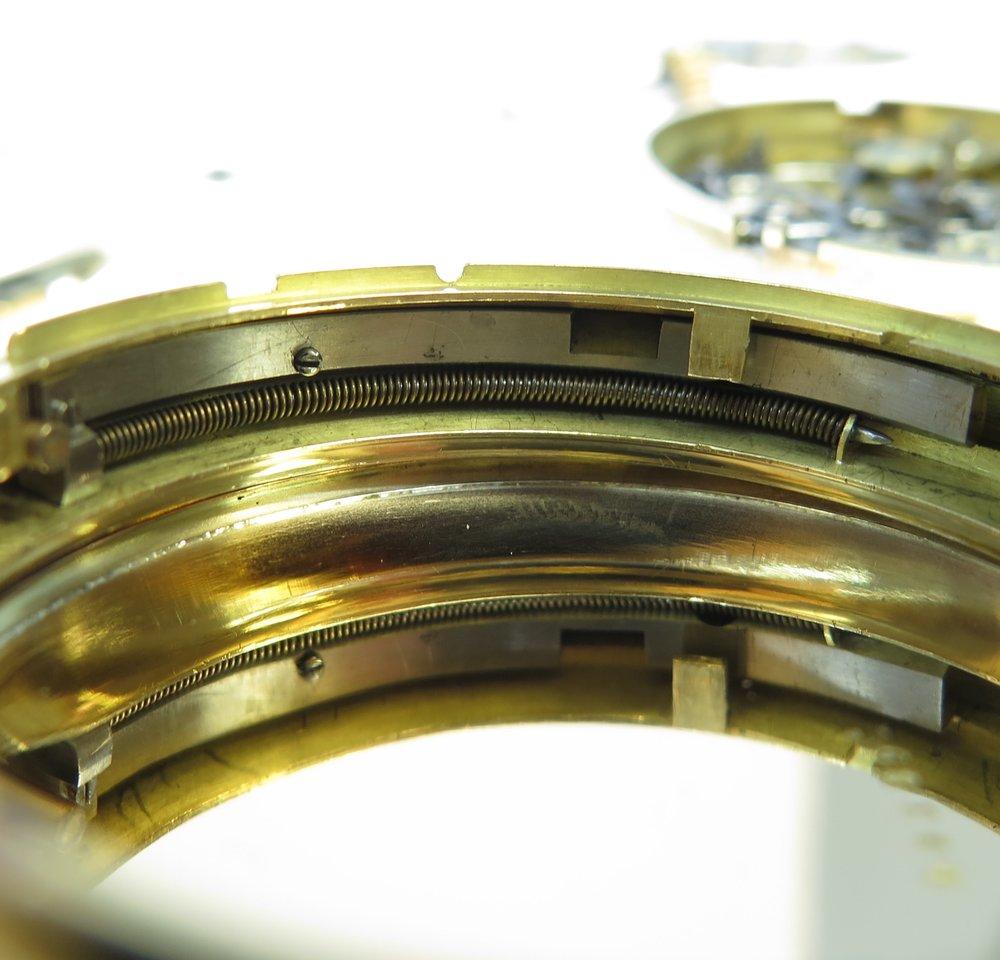 Inner case repeater slider spring