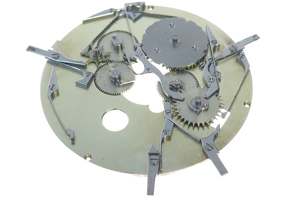 The perpetual calendar module, held in place by 3 screws onto the movement.