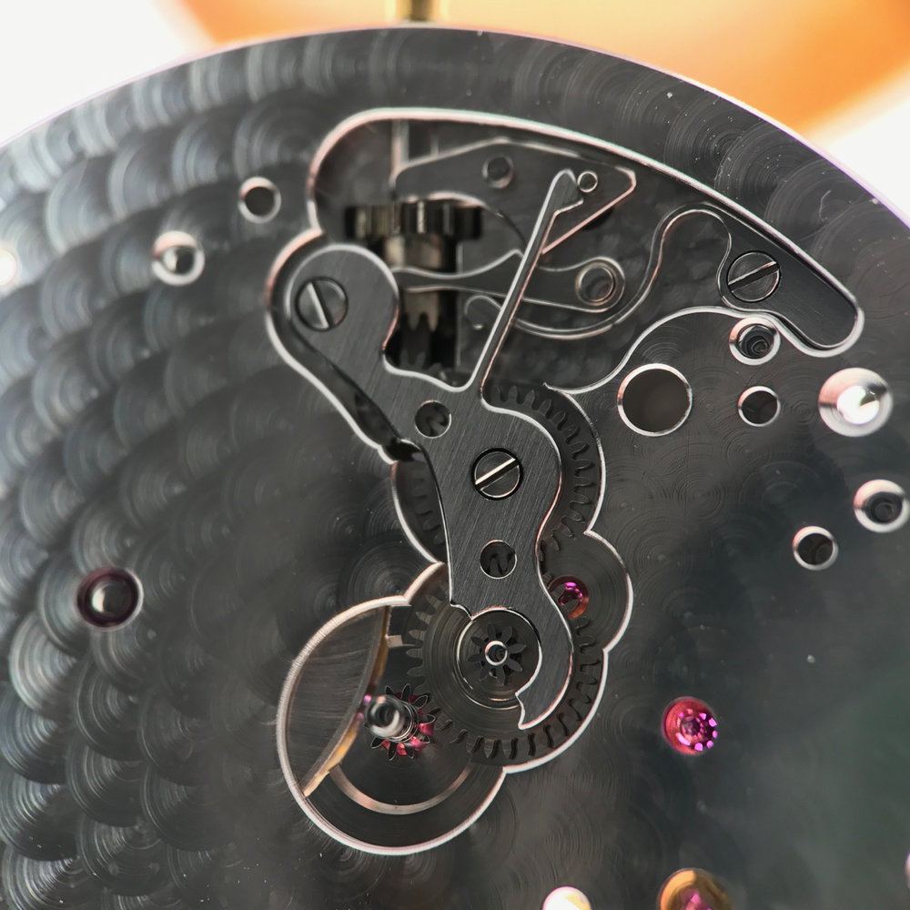 The fully assembled and finished setting mechanism taken from the movement found below.