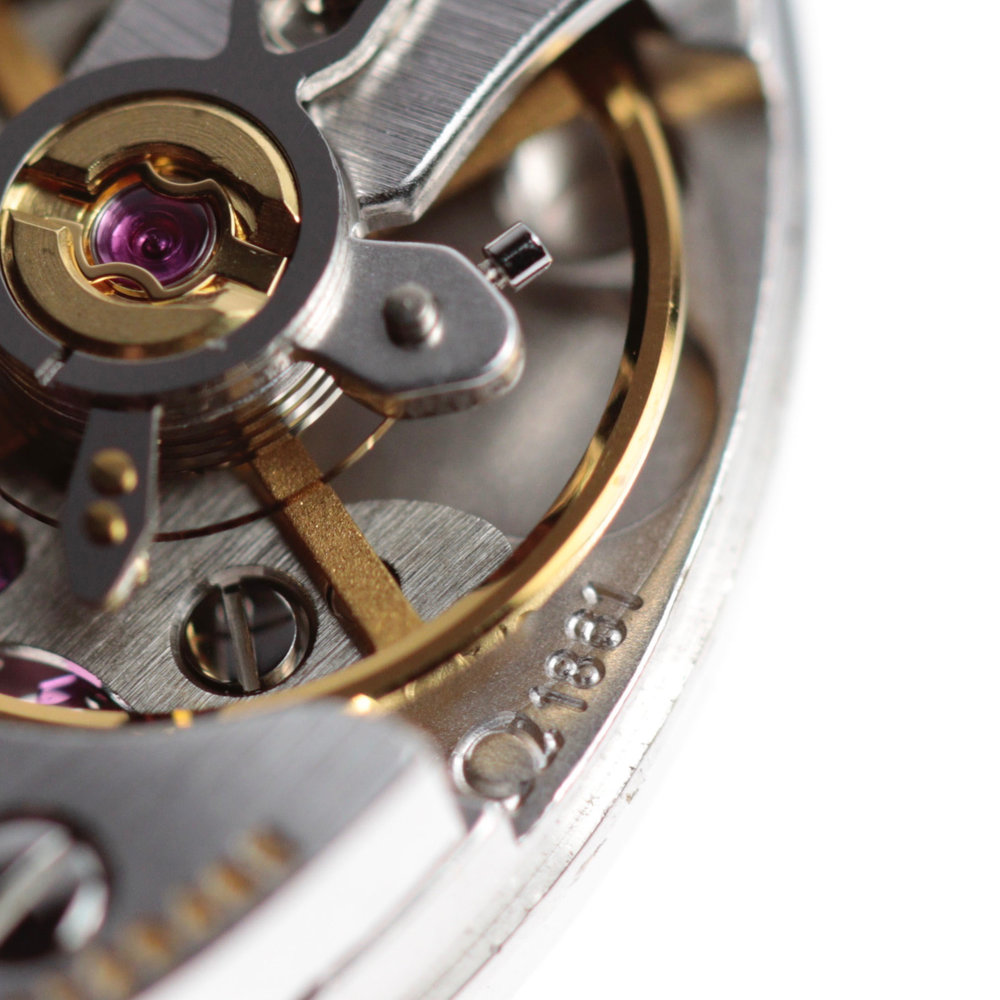 The calibre Omega 1861, below the balance wheel