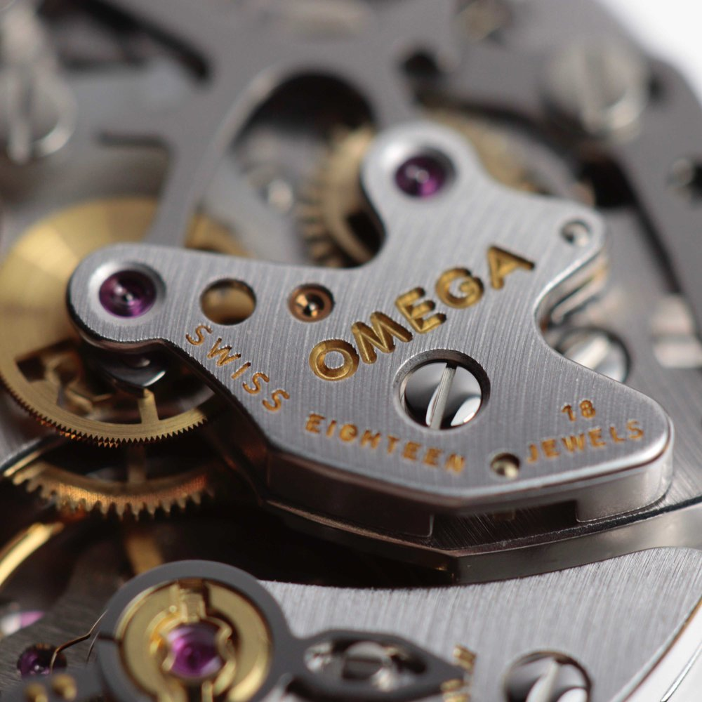 The engraved bridge holding in place the  chronograph and minute recording wheels