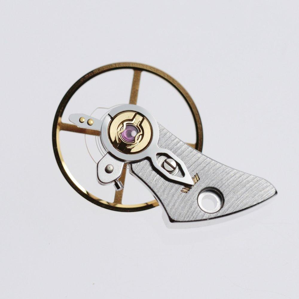 Balance wheel and balance cock