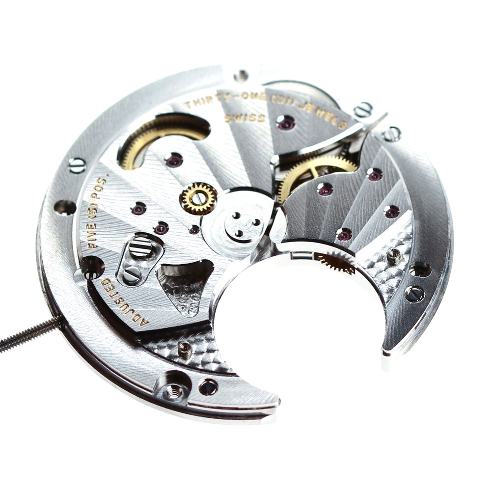 The flying tourbillon assembly removed from the back of the movement
