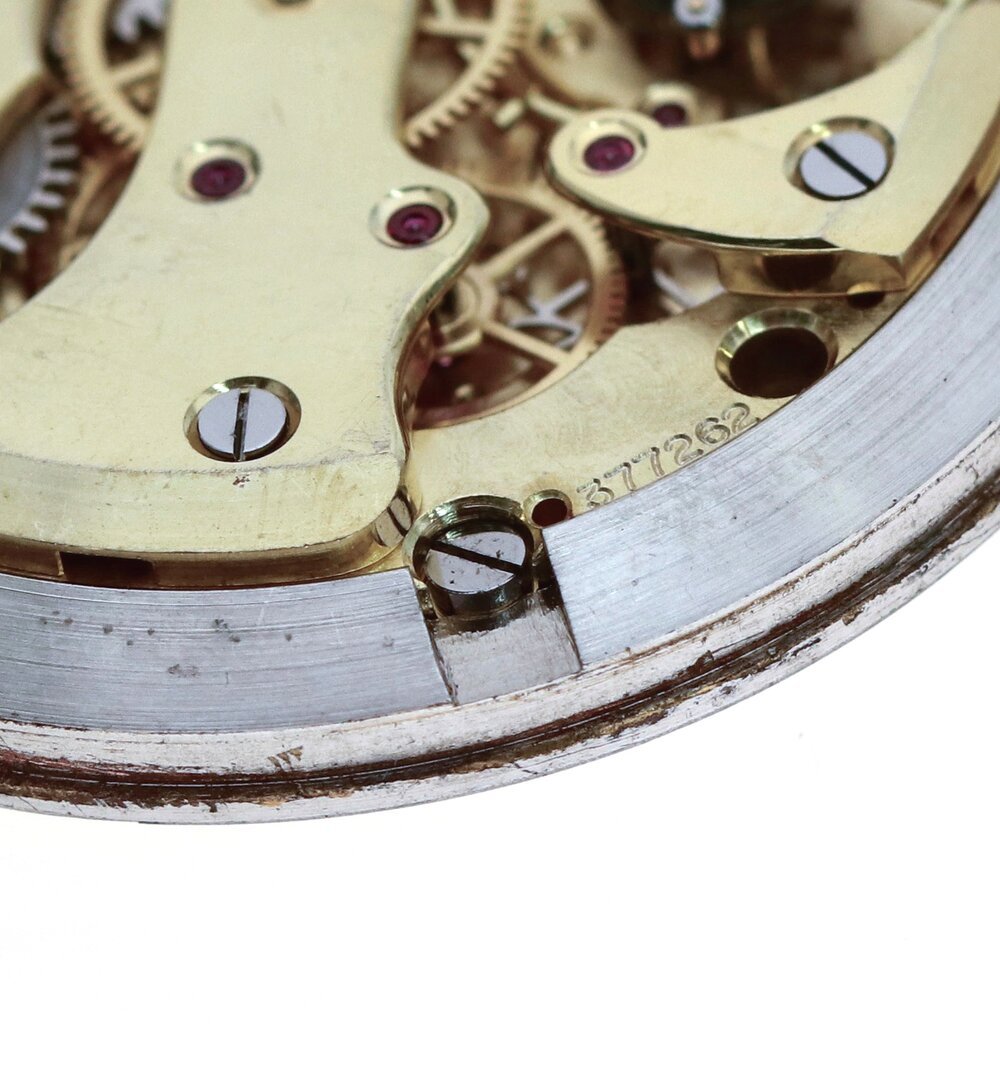 The central screw holds the movement into the movement ring and the movement ring pushes tight into the case back