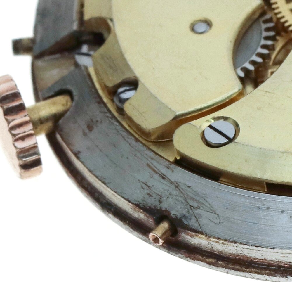 The pushers protrude through the movement ring and are apparent on the other surface of the case