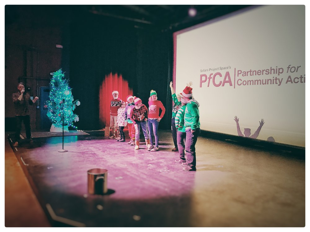 Ugly Sweater Contest participants having fun prior to the screening of White Christmas at the SteamPlant Theater on Monday, December 18.